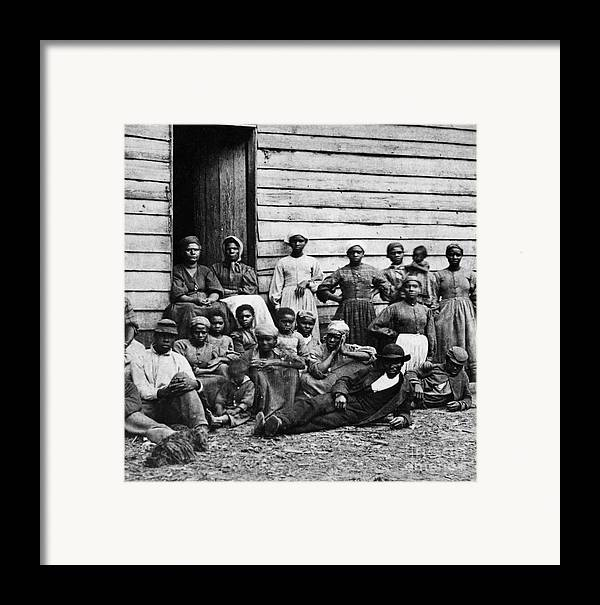 Slavery Framed Print featuring the photograph A Group Of Slaves by Photo Researchers