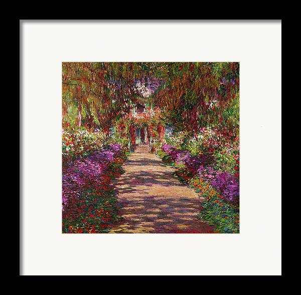 Pathway Framed Print featuring the painting A Pathway In Monets Garden Giverny by Claude Monet