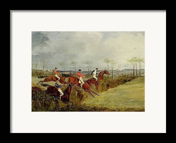 Steeplechase Framed Print featuring the painting A Steeplechase - Taking A Hedge And Ditch by Henry Thomas Alken