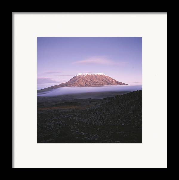 Africa Framed Print featuring the photograph A View Of Snow-capped Mount Kilimanjaro by David Pluth