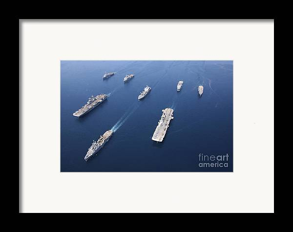 Color Image Framed Print featuring the photograph Amphibious Task Force-west In Formation by Stocktrek Images