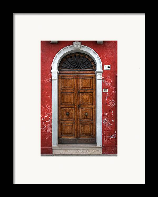 Door Framed Print featuring the photograph an old wooden door in Italy by Joana Kruse