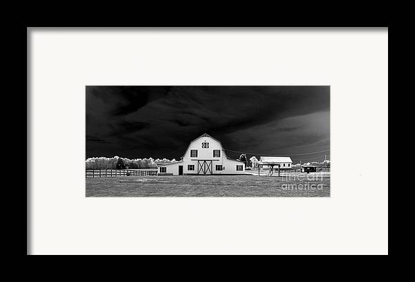 Barn Storm Framed Print featuring the photograph Barn Storm by Julian Bralley