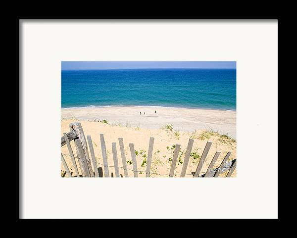 Beach Fence Framed Print featuring the photograph beach fence and ocean Cape Cod by Matt Suess
