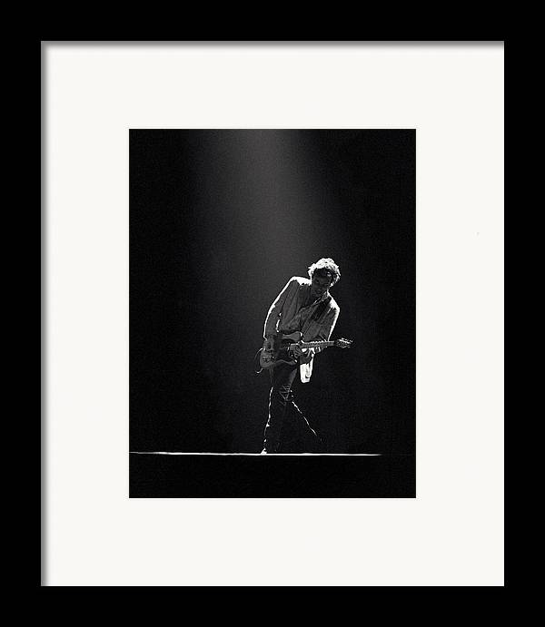Bruce Springsteen Framed Print featuring the photograph Bruce Springsteen In The Spotlight by Mike Norton