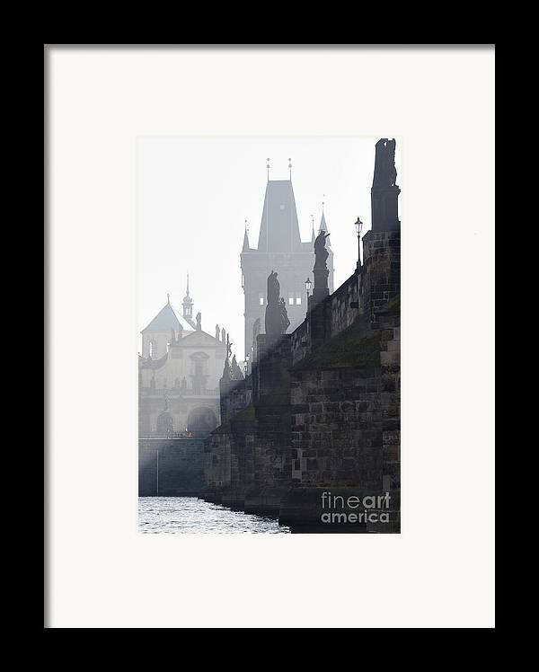Bridge Framed Print featuring the photograph Charles Bridge In The Early Morning Fog by Michal Boubin