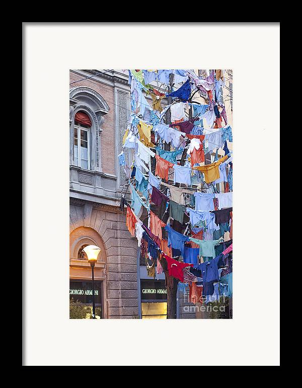 Angel Framed Print featuring the photograph Clothes In The Street by Andre Goncalves