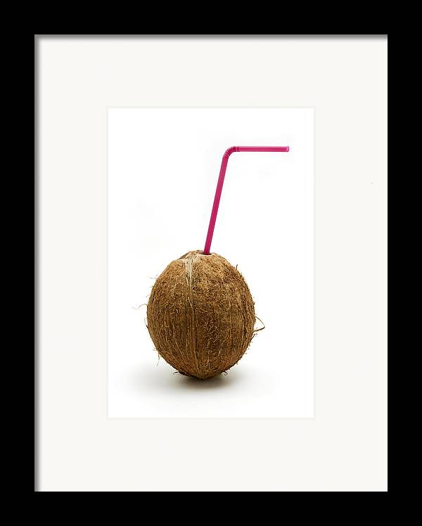 White Background Framed Print featuring the photograph Coconut With A Straw by Fabrizio Troiani