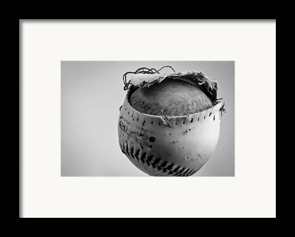 Dog's Ball Framed Print featuring the photograph Dog's Ball by Bob Orsillo