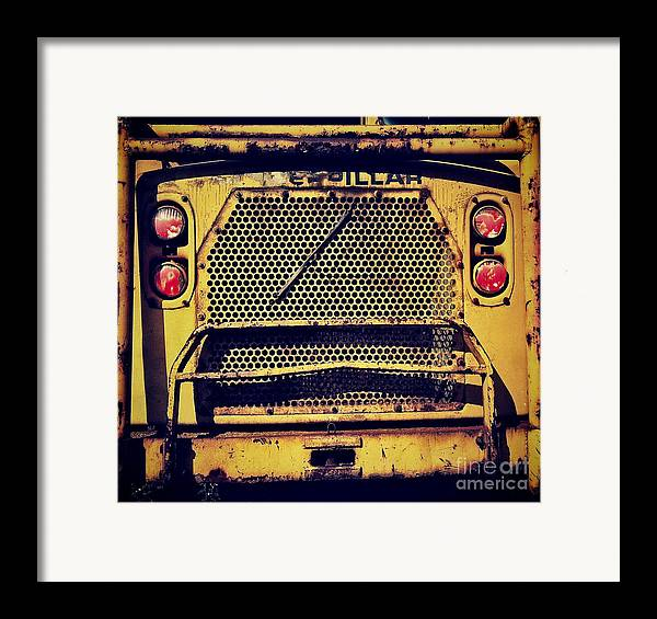 Caterpillar Framed Print featuring the photograph Dump Truck Grille by Amy Cicconi