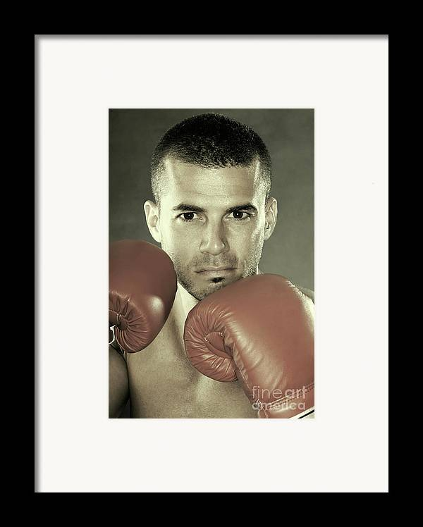 Kickboxer Framed Print featuring the photograph Kickboxer by Oleksiy Maksymenko