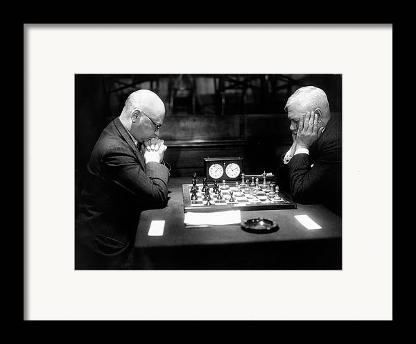 55-59 Years Framed Print featuring the photograph Mature Men Playing Chess, Profile (b&w) by Hulton Archive