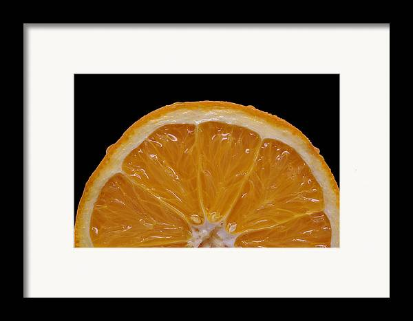Isolated Object Framed Print featuring the photograph Orange Sunrise On Black by Laura Mountainspring
