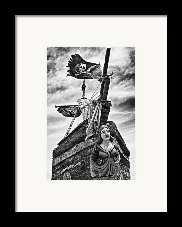 Pirate Ship Framed Print featuring the photograph Pirate Ship And Black Flag by Garry Gay
