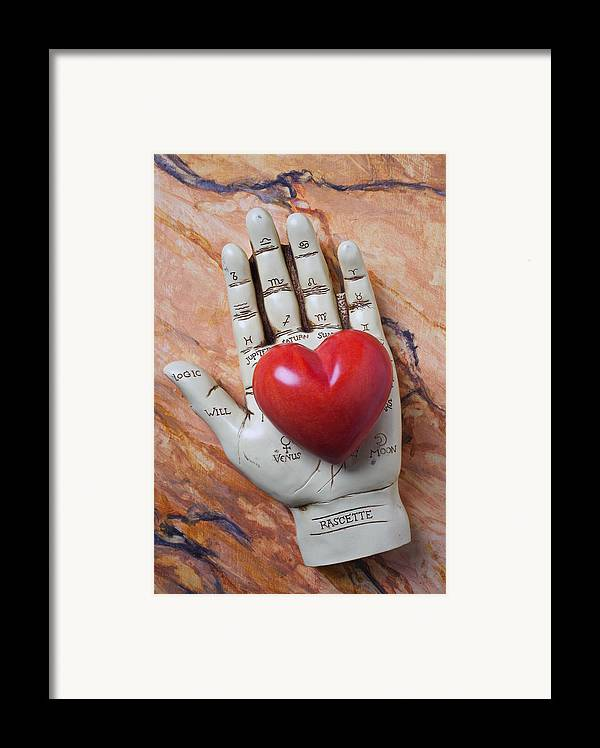 Palm Reader Hand Framed Print featuring the photograph Plam Reader Hand Holding Red Stone Heart by Garry Gay
