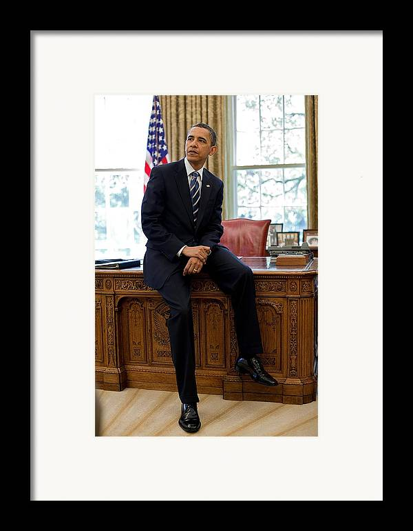 History Framed Print featuring the photograph President Barack Obama Sits On The Edge by Everett