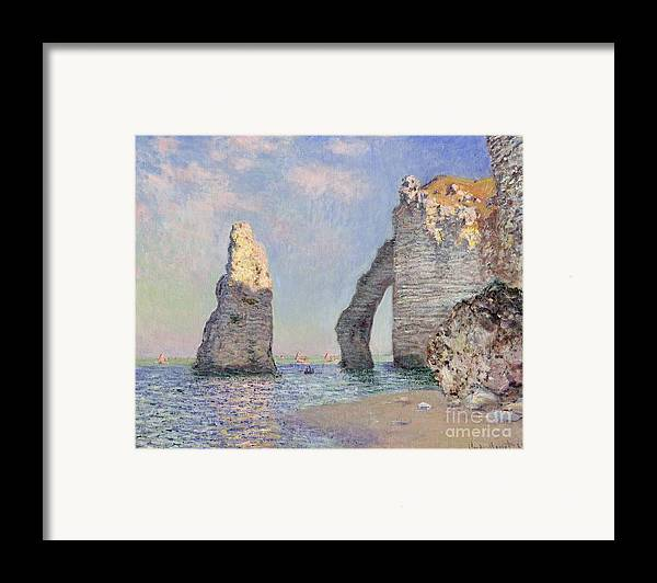 The Cliffs At Etretat Framed Print featuring the painting The Cliffs At Etretat by Claude Monet