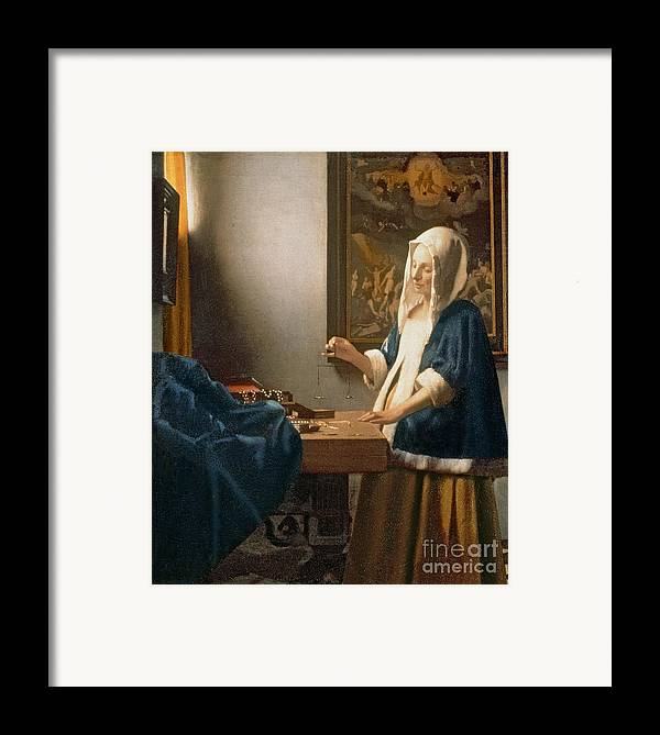 Vermeer Framed Print featuring the painting Woman Holding A Balance by Jan Vermeer