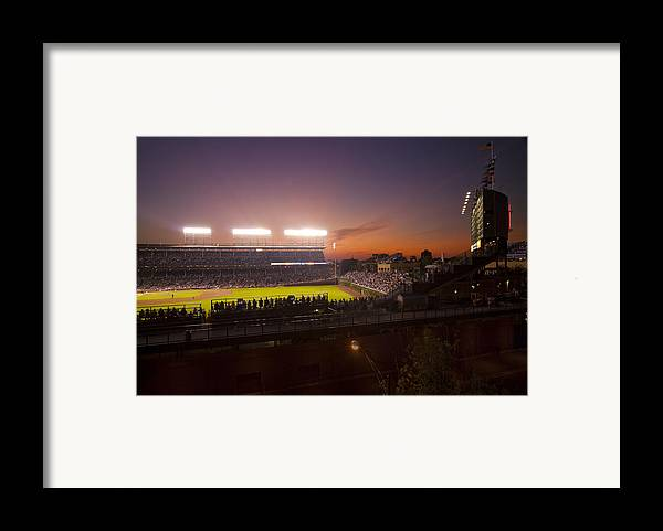 Cubs Framed Print featuring the photograph Wrigley Field At Dusk by Sven Brogren