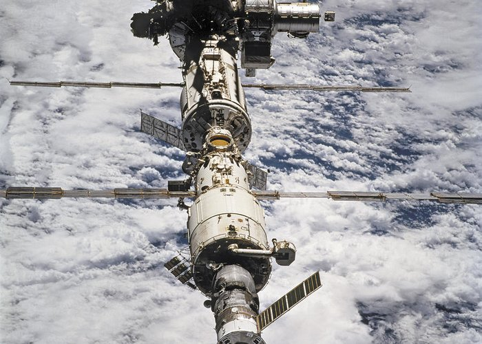 No People; Square Image; Outdoors; Day; Elevated View; Mid-air; Flying; Science; Technology; Travel; Space Station; Space Mission; Earth; Space; Space Exploration; 2009; Planet; Cloud Greeting Card featuring the photograph International Space Station by Anonymous