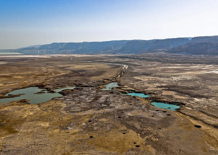 Israel Greeting Card featuring the photograph Sinkholes In Northern Dead Sea Area by Ofir Ben Tov