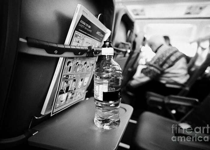 Interior Greeting Card featuring the photograph Bottle Of Water On Tray Table Interior Of Jet2 Aircraft Passenger Cabin In Flight Europe by Joe Fox