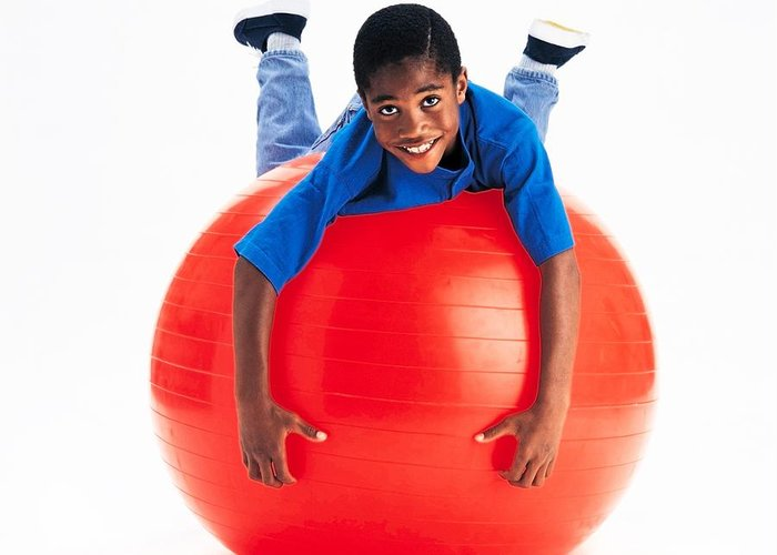 Child Greeting Card featuring the photograph Boy Balancing On Exercise Ball by Ron Nickel
