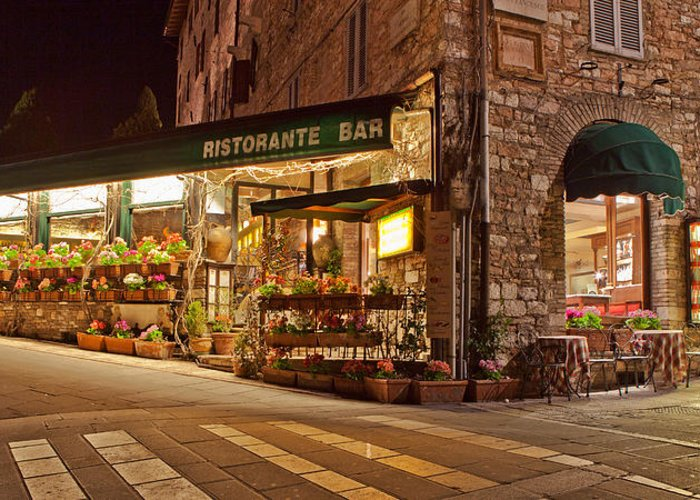 Store Greeting Card featuring the photograph Cafe In Assisi At Night by Susan Schmitz