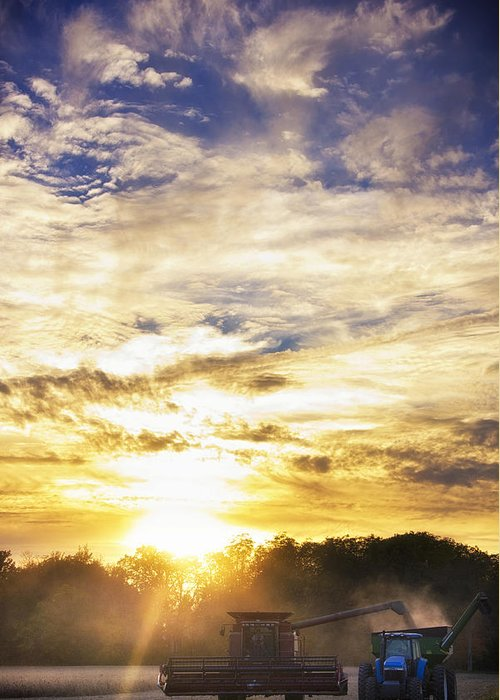 Sun Greeting Card featuring the photograph Combine At Sunset by Michael Huddleston