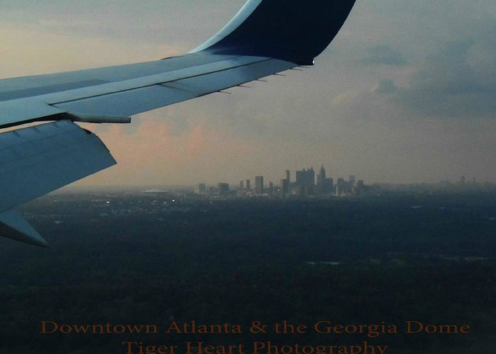 This Photo Was Taken As We Were Flying Into Atlanta On 08/10/2012 From Being In Paris The Week Before. This Is Taken At Some Distance & The Photo Of Downtown Atlanta's Cityscape Including The Georgia Dome Can Be Seen From The Window Seat On The Plane. You Can See The Right Wing Of The Plane In The Foreground Greeting Card featuring the photograph Downtown Atlanta And The Georgia Dome by Michelle Adcock