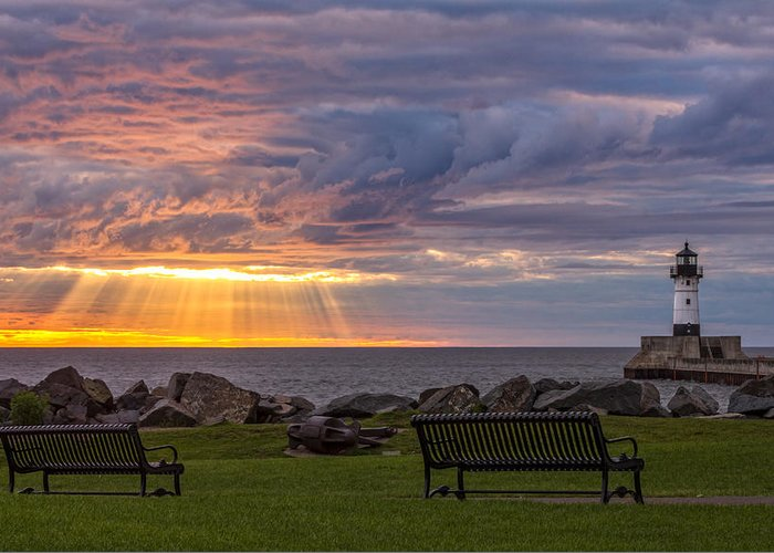 front Row Seats lake Superior canal Park canal Park Lighthouse duluth north Shore Sunrise Dawn Rays god Rays Clouds Benches Lighthouse great Lake Sunset Sunrays Magic Nature Summer perfect Duluth Day mary Amerman Greeting Card featuring the photograph Front Row Seats by Mary Amerman