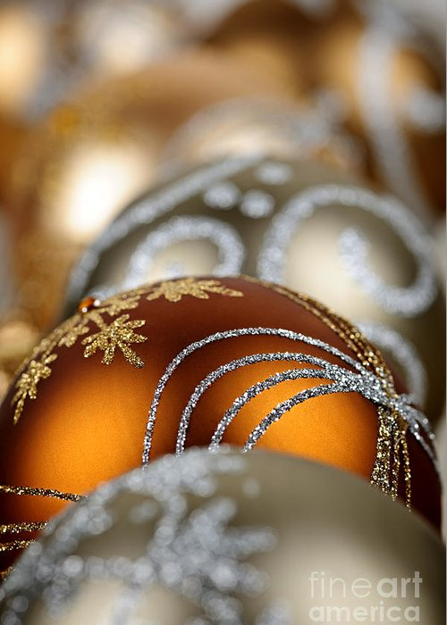 Christmas Greeting Card featuring the photograph Gold Christmas Ornaments by Elena Elisseeva