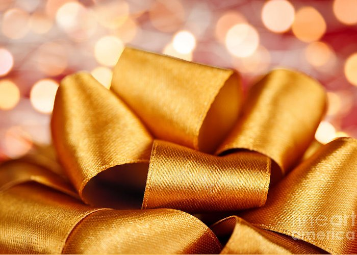 Gift Bow Greeting Card featuring the photograph Gold Gift Bow With Festive Lights by Elena Elisseeva
