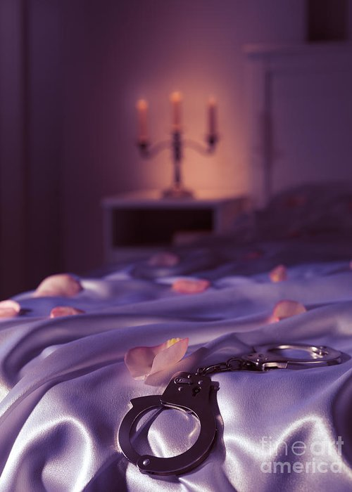 Bondage Greeting Card featuring the photograph Handcuffs And Rose Petals On Bed by Oleksiy Maksymenko