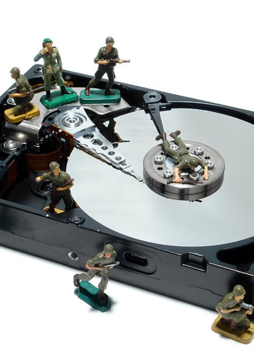 Computer Greeting Card featuring the photograph Hard Drive Defense by Olivier Le Queinec