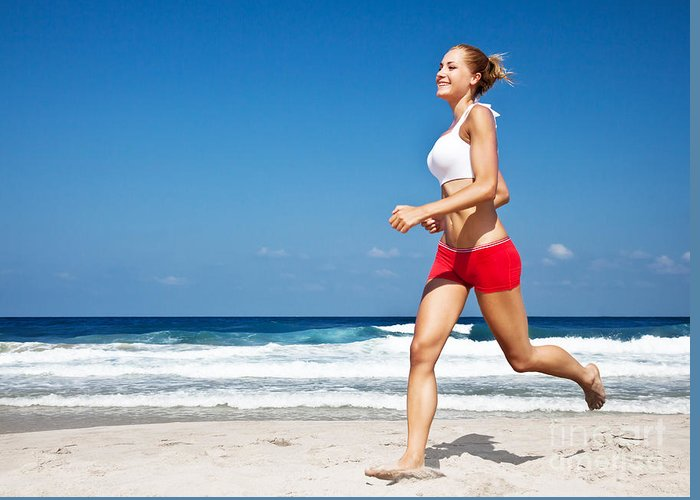 Action Greeting Card featuring the photograph Healthy Woman Running On The Beach by Anna Omelchenko