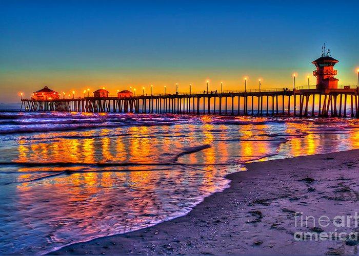 Huntington Beach Greeting Card featuring the photograph Huntington Beach Pier Sundown by Jim Carrell