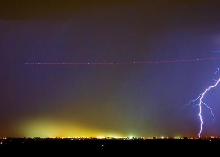 Lightning Greeting Card featuring the photograph Jet Over Colorful City Lights And Lightning Strike Panorama by James BO Insogna