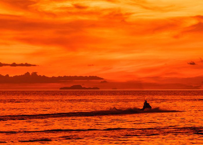 Asia Greeting Card featuring the photograph Jetski Ride Into The Sunset by Colin Utz