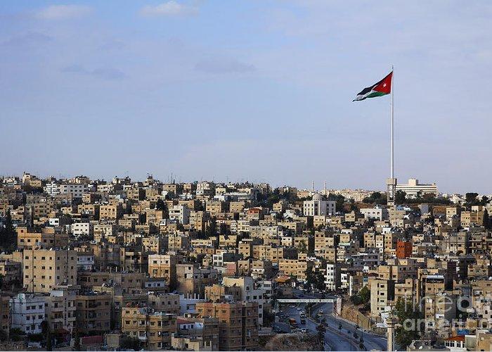 Amman Greeting Card featuring the photograph Jordanian Flag Flying Over The City Of Amman Jordan by Robert Preston