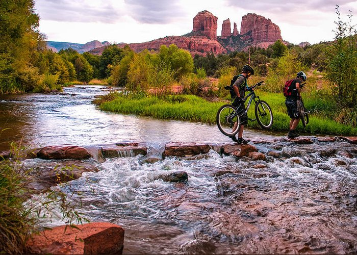 Cathedral Crossing Greeting Card featuring the photograph Mountain Bikers Crossing Cathedral Falls by Linda Pulvermacher