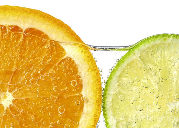 Orange Greeting Card featuring the photograph Orange And Lime Slices In Water by Elena Elisseeva