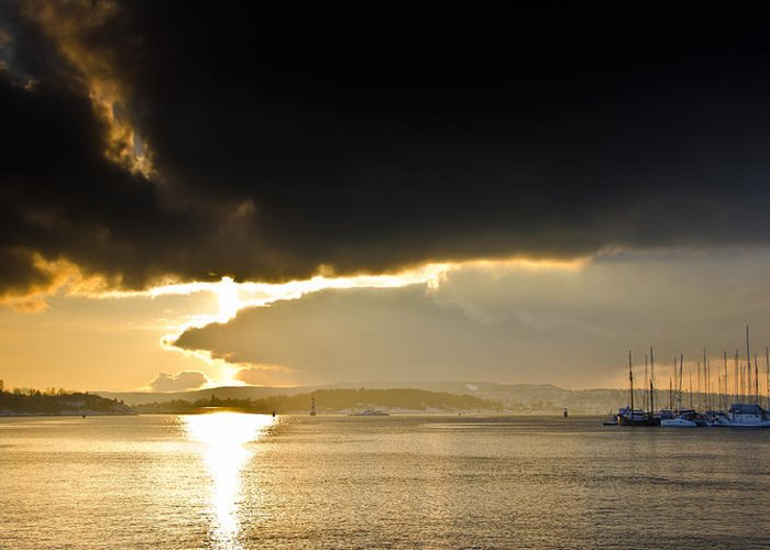 Sunset Greeting Card featuring the photograph Oslo Harbor Sunset by Aaron S Bedell