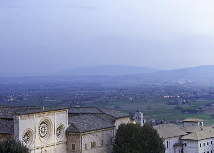 Italy Greeting Card featuring the photograph Panoramic View Of Assisi At Night by Susan Schmitz