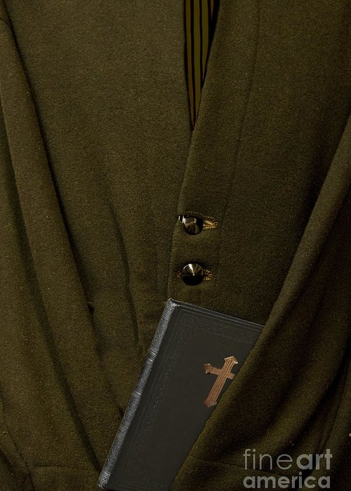 Mens; Old; Grunge; Bible; Binding; Side View; Cross; Metallic; Symbol; Religion; Book; Words; Symbolism; Close Up; Still Life; Object; Read; Prayer; Religious; Priest; Man; Dark; Darkness; Faith; God; Jesus; Clergy; Buttons; Jacket; Christian; Catholic; Greeting Card featuring the photograph Priest by Margie Hurwich