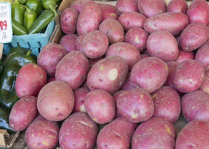 Red Greeting Card featuring the photograph Red Skin Potatoes Stall Display by JPLDesigns