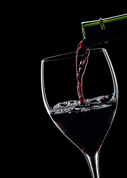 Red Wine Pouring Into Wineglass Greeting Card featuring the photograph Red Wine Pouring Into Wineglass Splash Silhouette by Alex Sukonkin