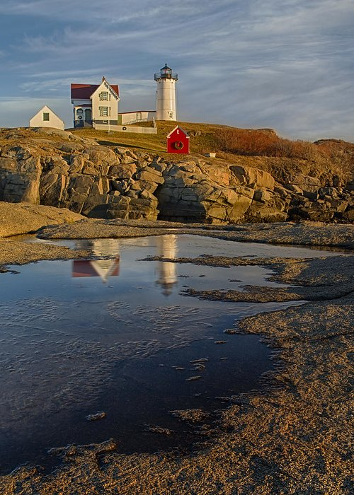 Nubble Lighthouse Greeting Card featuring the photograph Reflecting On Nubble Lighthouse by Susan Candelario