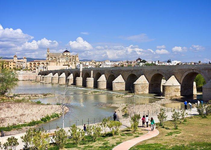 Ancient Greeting Card featuring the photograph Roman Bridge In Cordoba by Artur Bogacki
