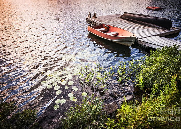 Boat Greeting Card featuring the photograph Rowboat At Lake Shore At Sunrise by Elena Elisseeva